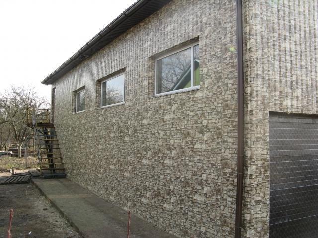 Фото отделки дома металлическим сайдингом под камень