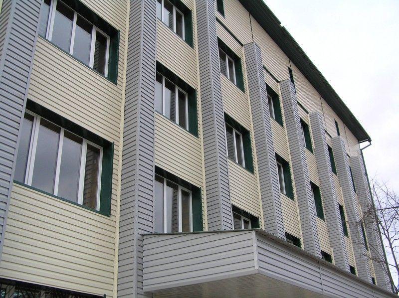 Облицовка сайдингом фасада многоэтажного дома