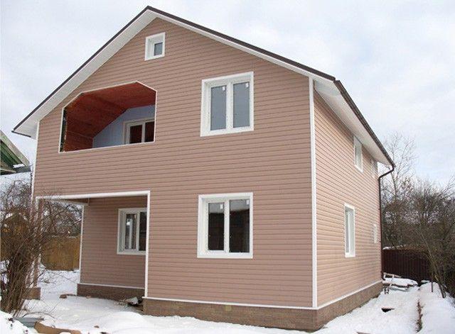 Фото фасада, отделанного канадским сайдингом