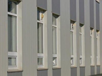 Отделка дома вертикальным сайдингом
