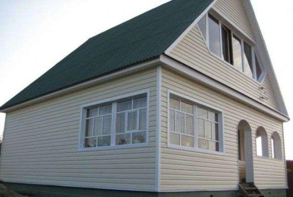 Фото дома, облицованного виниловым сайдингом