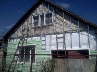 Отделка кирпичного дома сайдингом