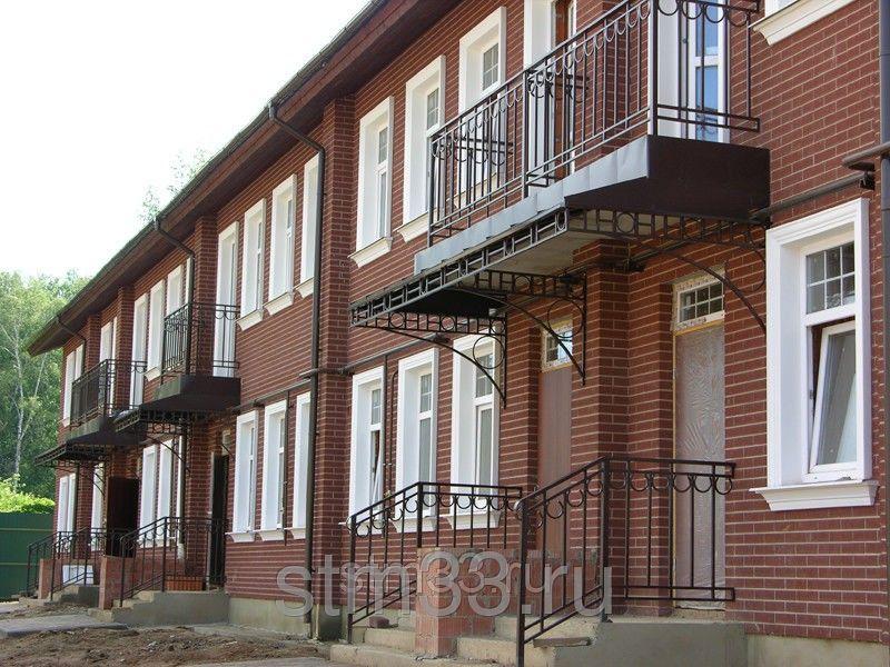 Многоквартирный дом, отделанный керамическим фасадным сайдингом. Дорого и со вкусом