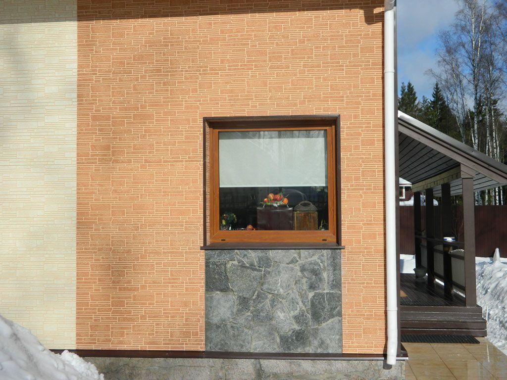 На фото, фасад, отделанный тремя видами фиброцементного сайдинга., не считая цокольного участка